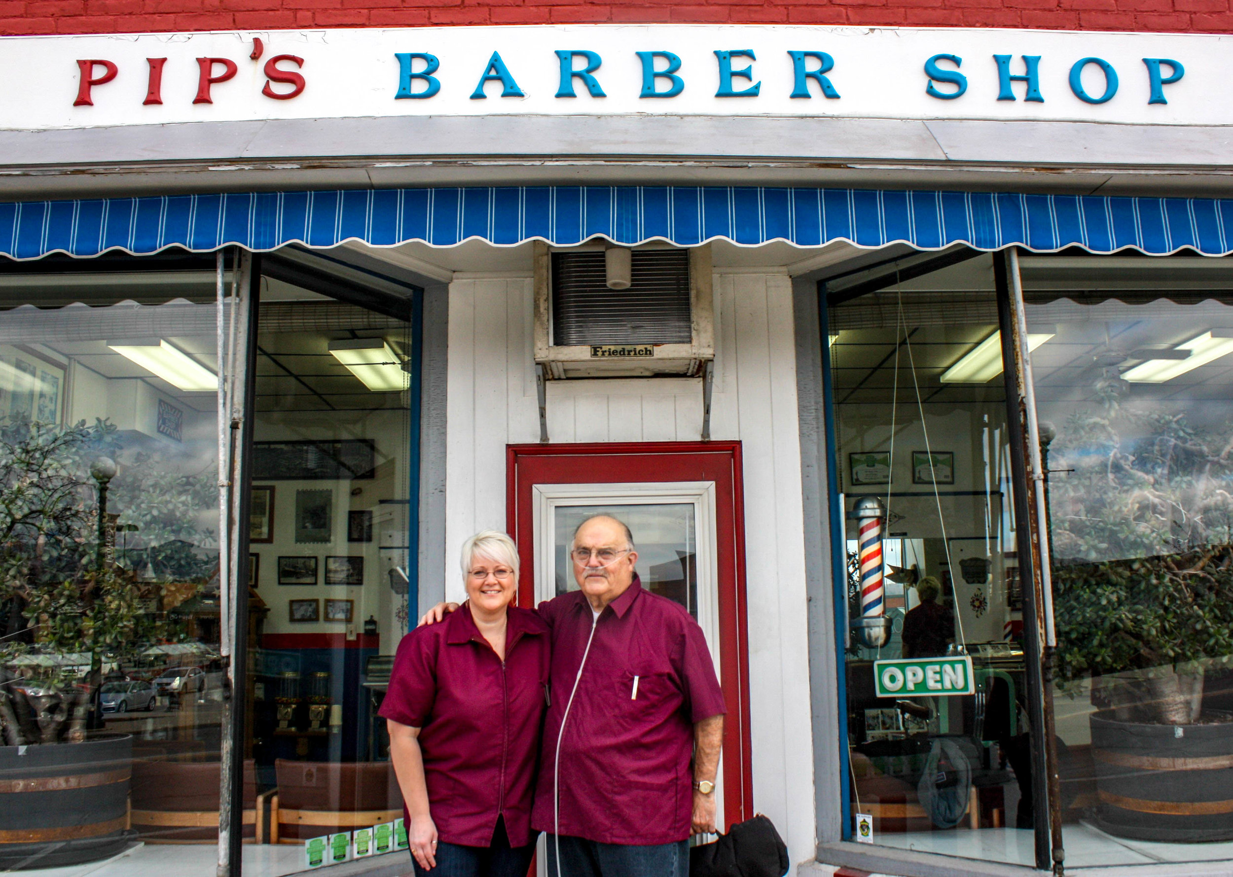 Marty Muscatello and his niece, Jessica Reynolds, stand in front of Pip's.