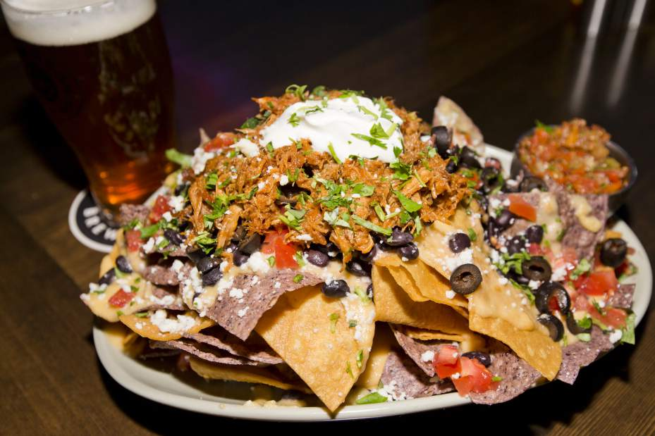 A plate of nachos similar to the ones offered at Hide-A-Way Tavern in Downtown Rutland. Photo credit: Bend Bulletin.