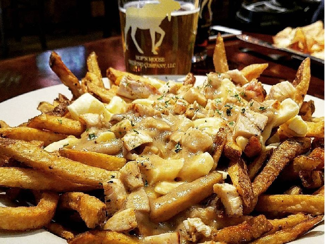 An order of poutine with a Rutland Beer Works draft at Hop'N Moose.