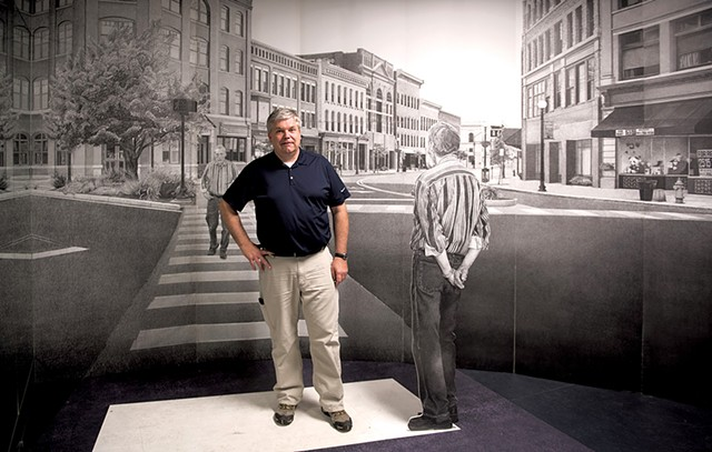 "Mark Foley stands in front of Bill Ramage's 'Rutland Drawing"" in the Opera House on Merchants Row. Photo by Seven Days staff photographer Caleb Kenna."
