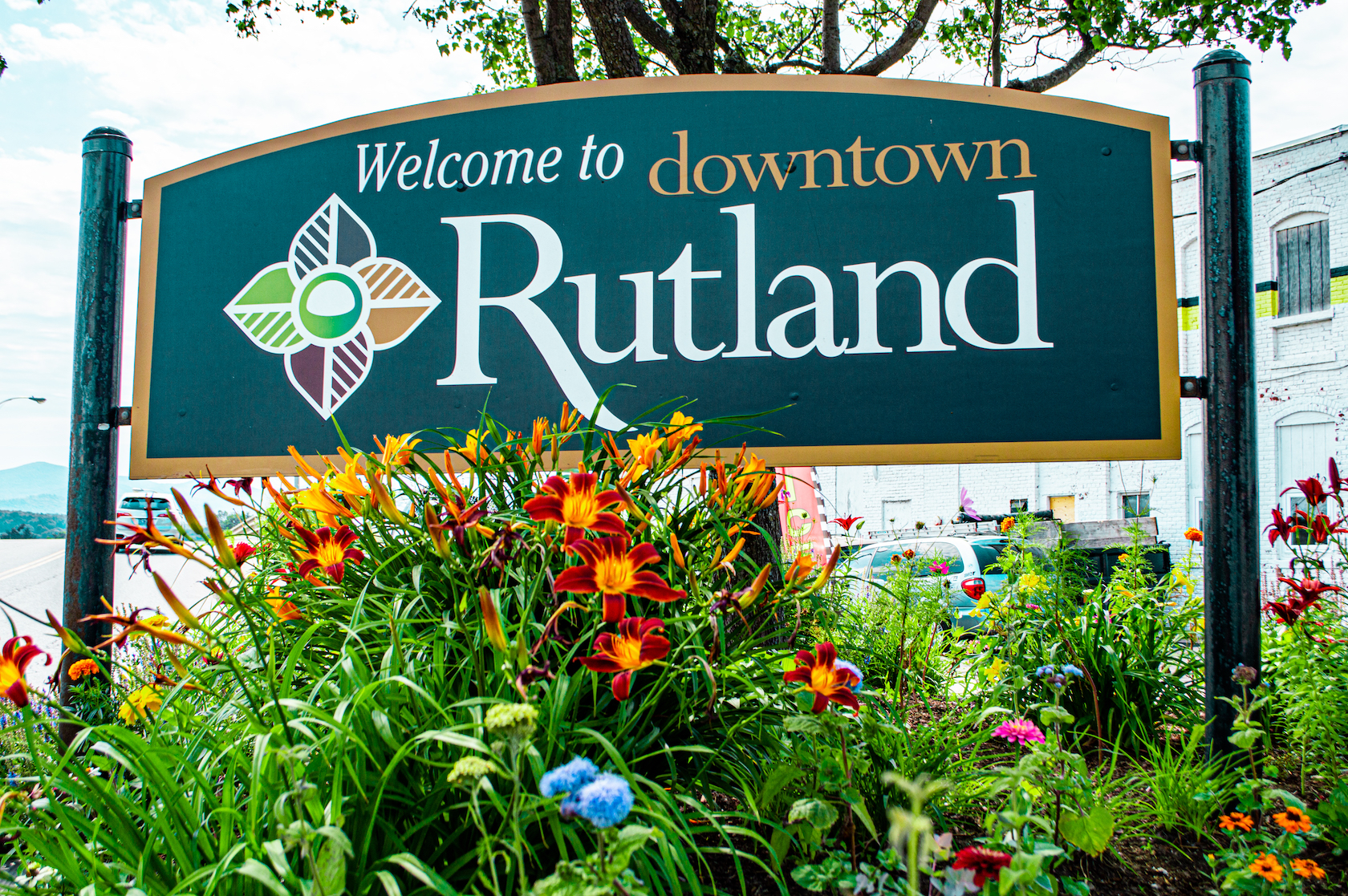 "An image of a ""Welcome to Downtown Rutland"" sign in the River Street Pocket Garden."