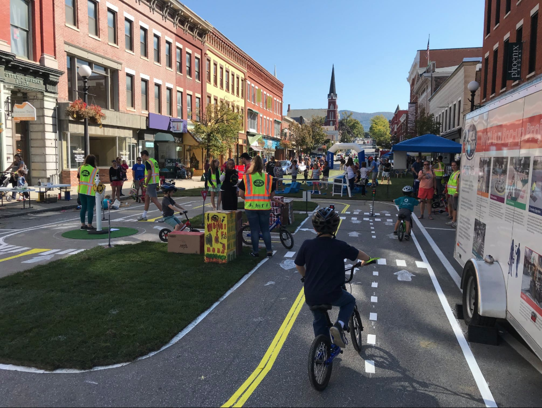 A child pedals in the traffic garden at the Green Street Challenge in Rutland, Vermont.