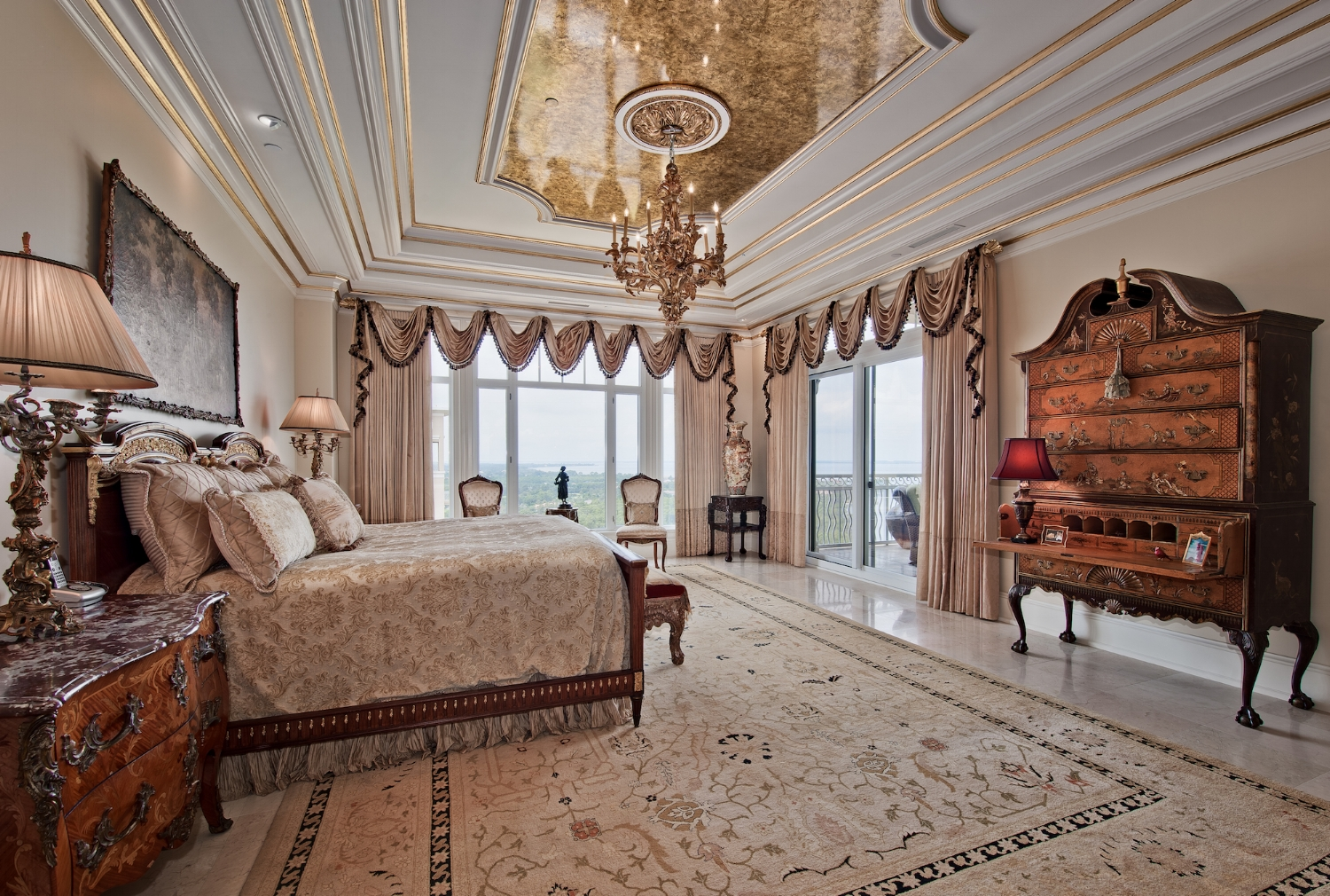 In this master bedroom the crown molding was gilded in selected areas and antiqued with a glaze. The ceiling was gilded and decoratively glazed.