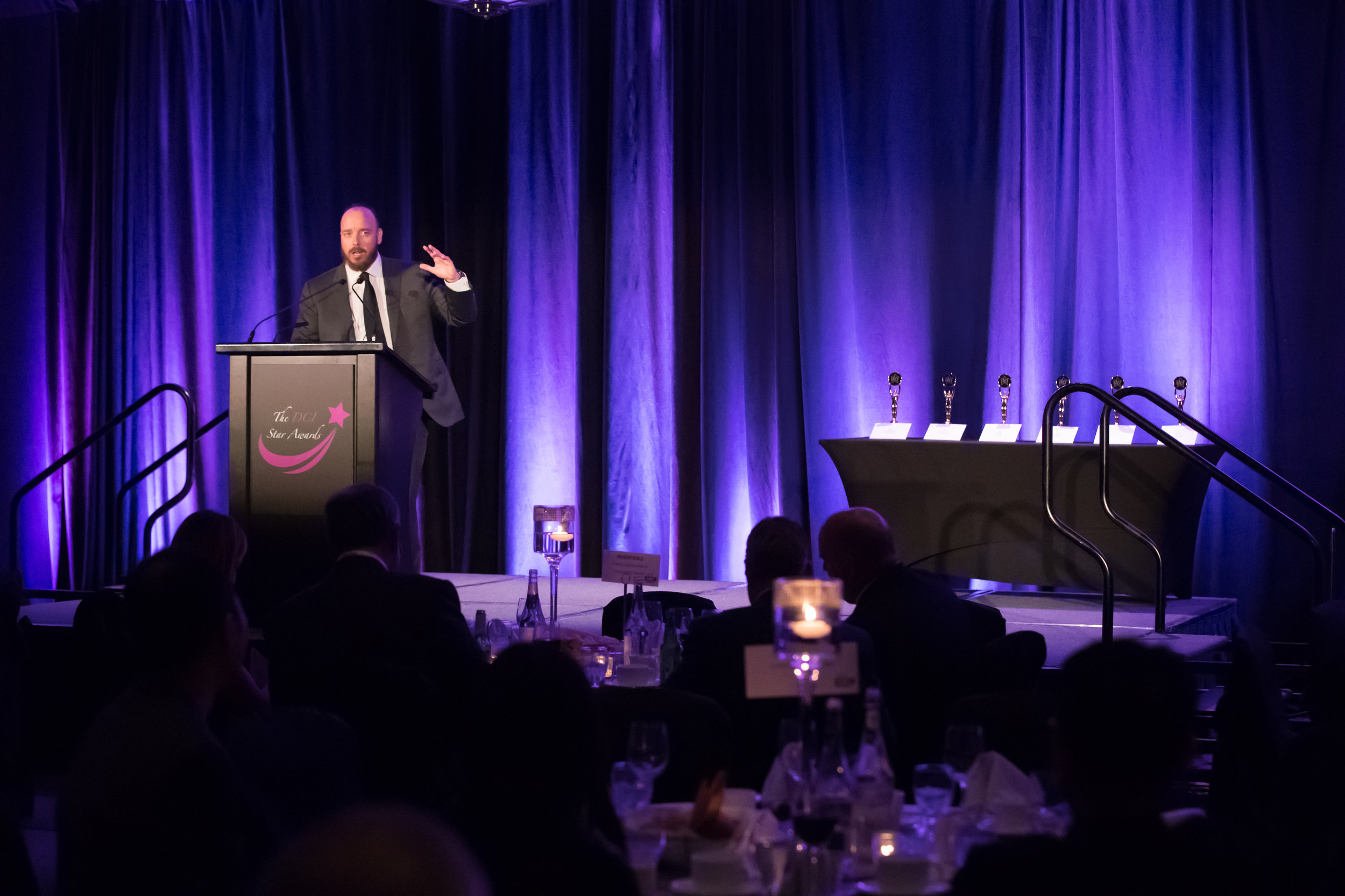 Evening Host and Comedian, Pete Zedlacher emcees the annual DCI Star Awards which commenced during the evening Gala Dinner of the 2018 DCI Business Summit.