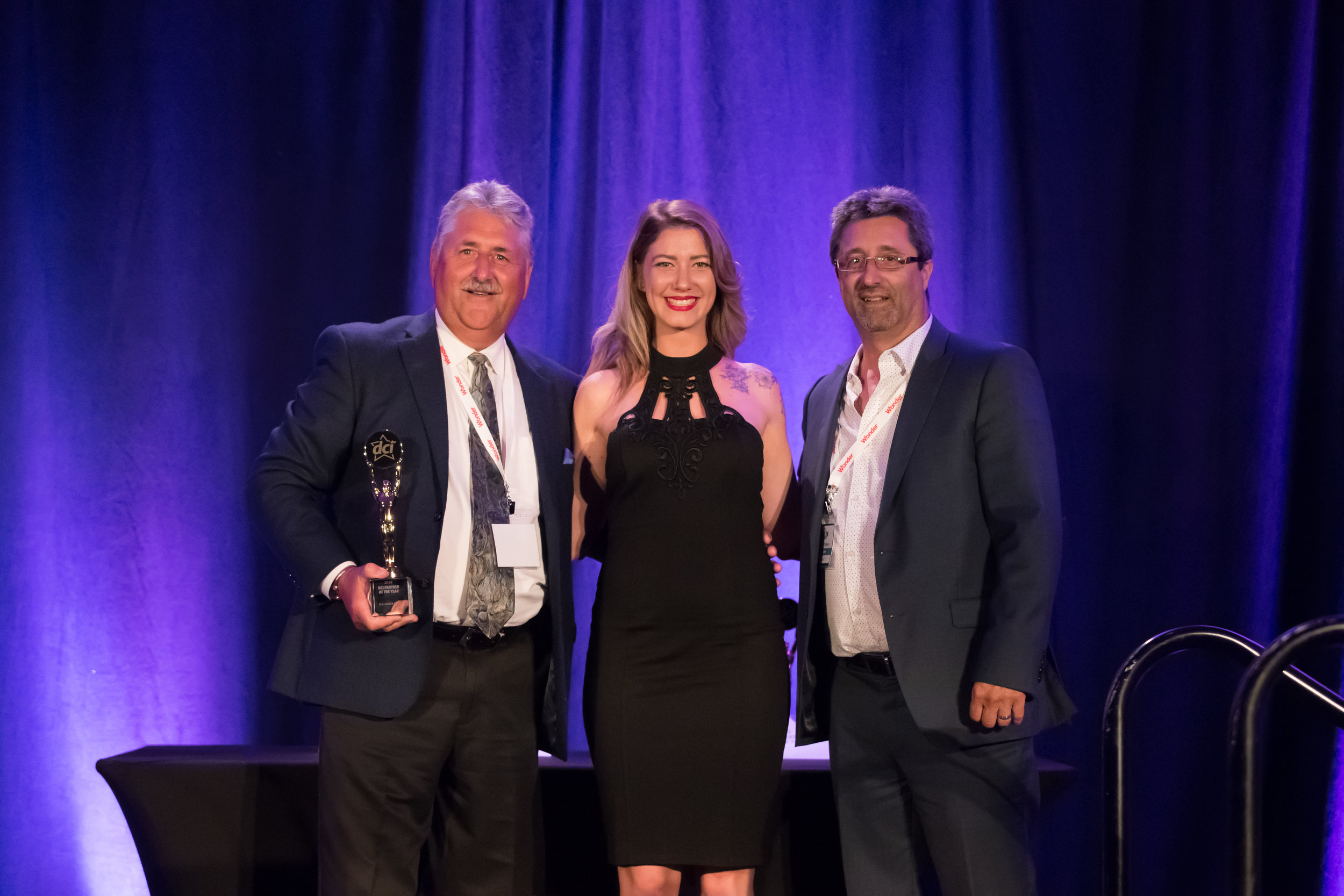 Greg McGrath (Left) and Mike Medeiros (Right) Pose With Star Awards Presenter (Centre)