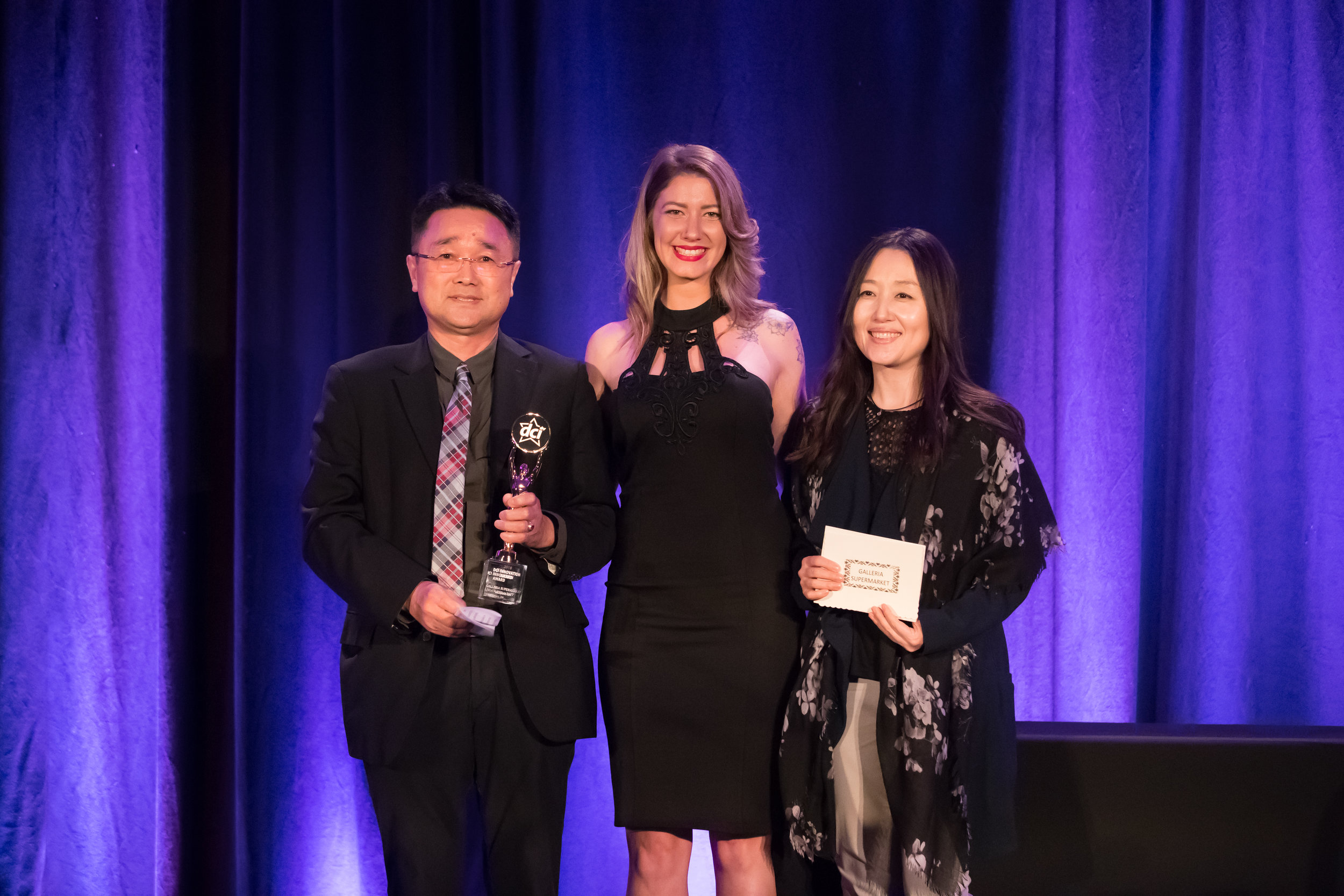 Peter Shin (Left) and Chris Yu (Right) With Star Awards Presenter (Centre)