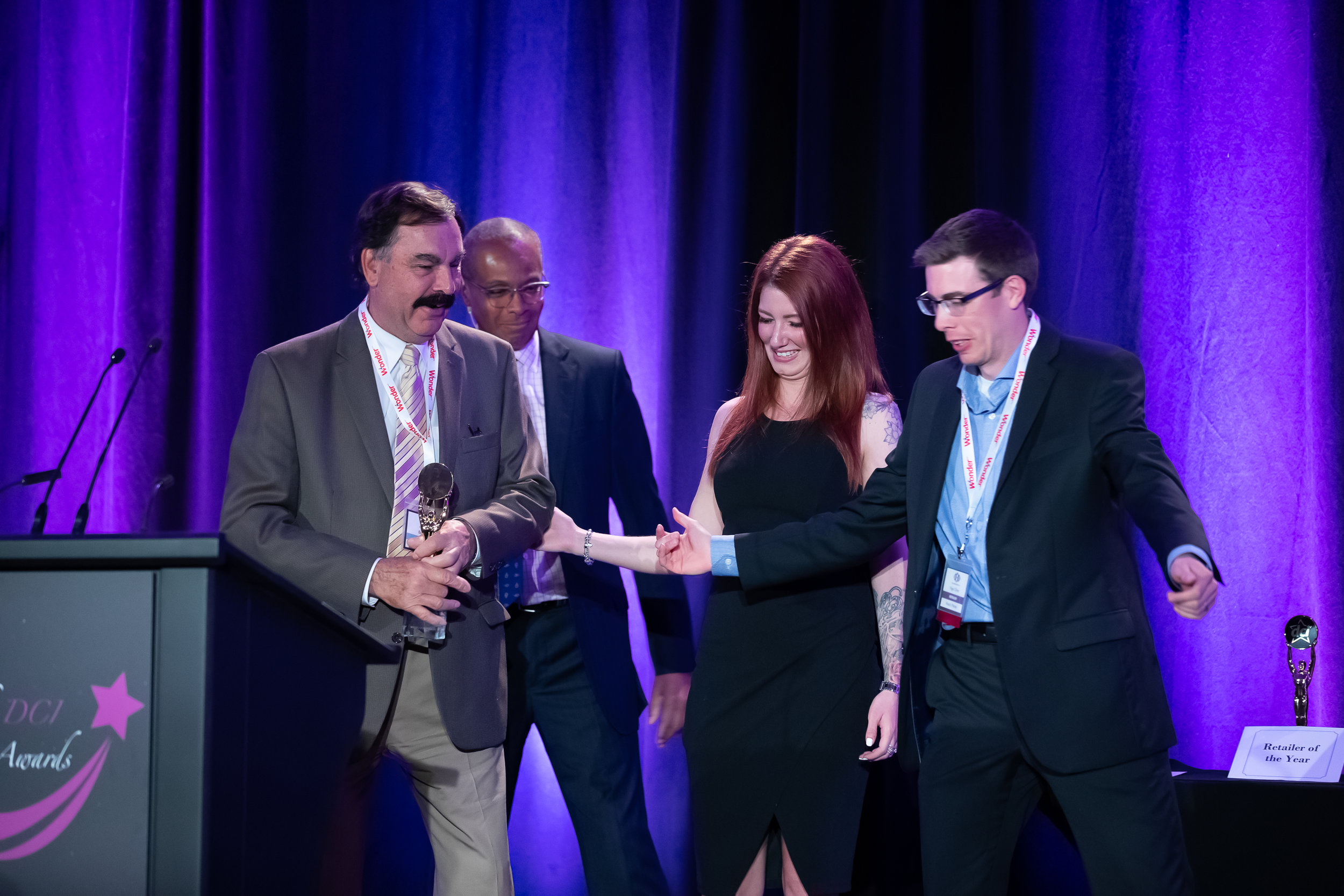 Bob Brema (William M. Dunne & Associates), Star Awards Emcee Evan Carter, Star Awards Presenter Melissa Lynne-Schaffer and DCI Treasurer Nigel Oliver of Vince's Market