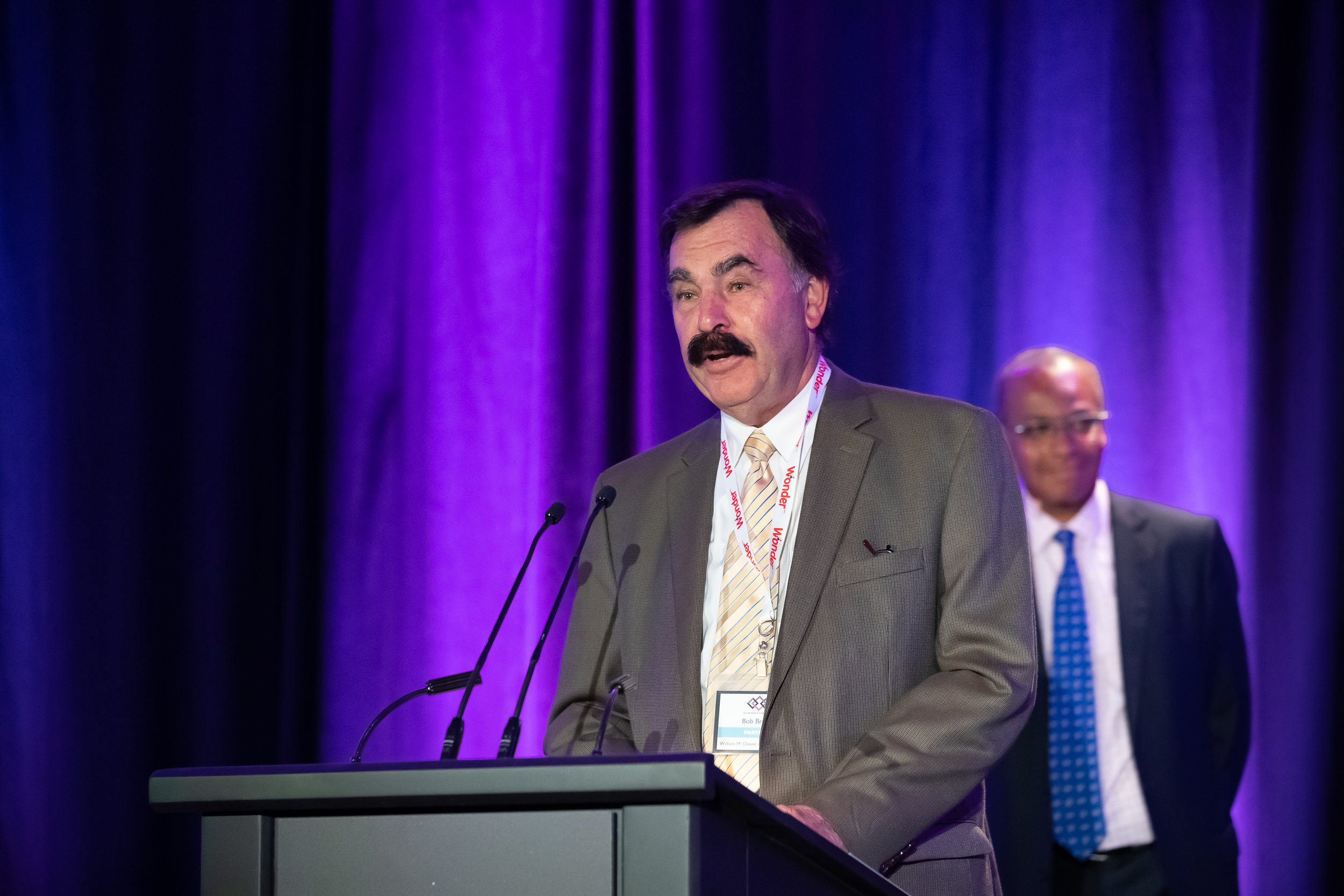 Bob Brema (William M. Dunne & Associates) accepts award on behalf of Chapman's Ice Cream
