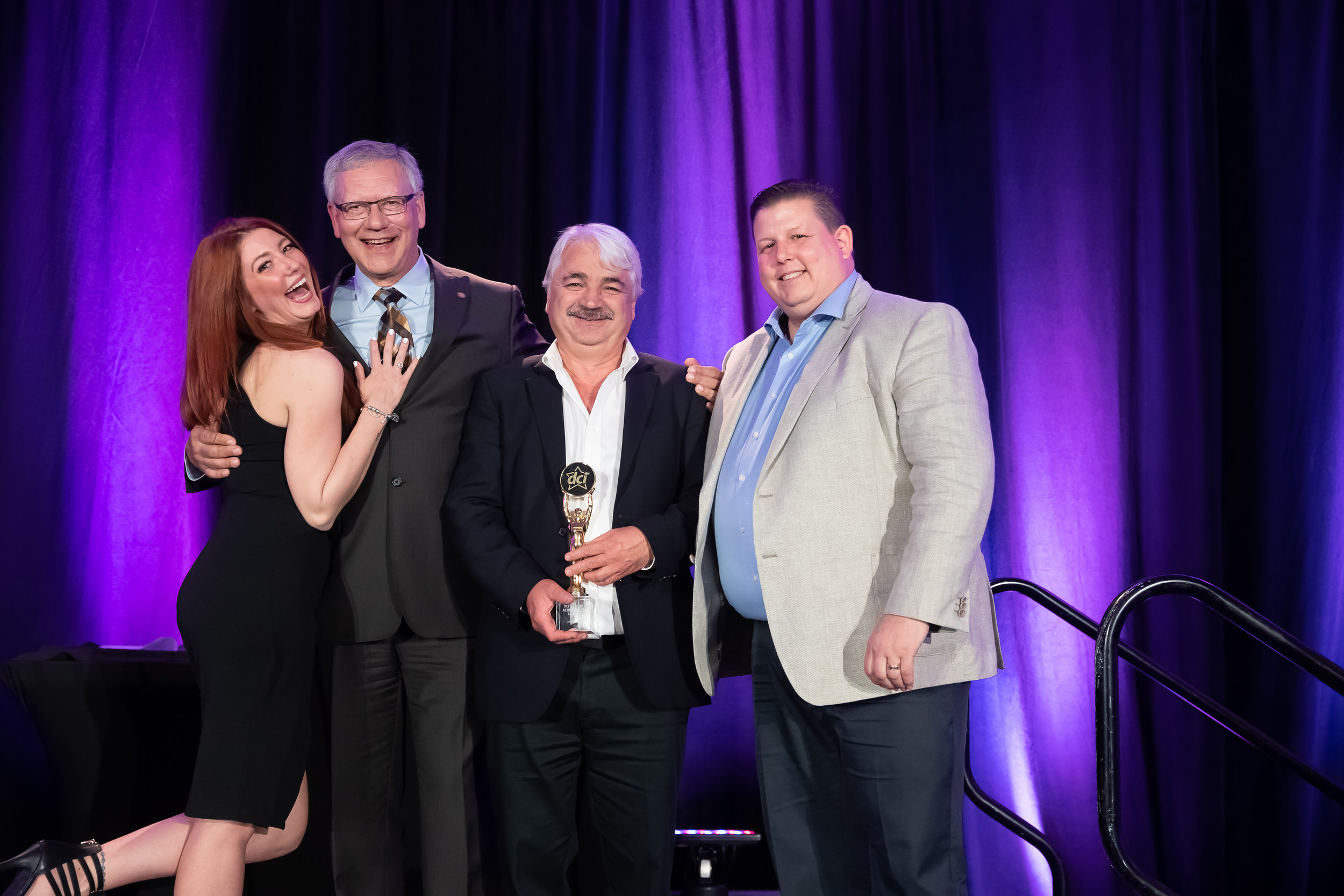 Star Awards Presenter Melissa Lynne-Schaffer, DCI Past Chair Dave Powell of Atlantic Grocery Distributors, Jim Bexis of Sun Valley Market and Barry Lanteigne of DCI