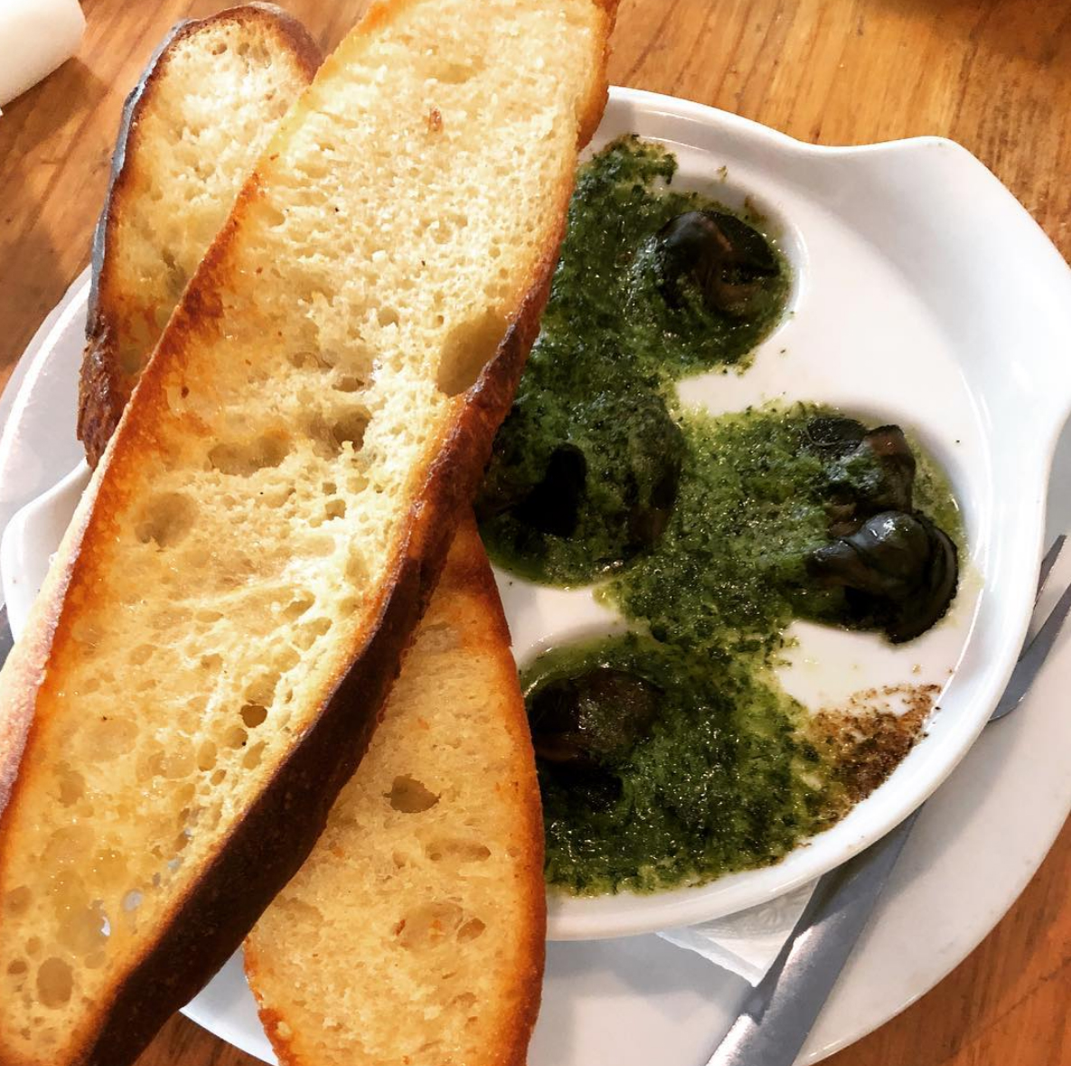 Fresh toasted bread, snails with herbs and butter