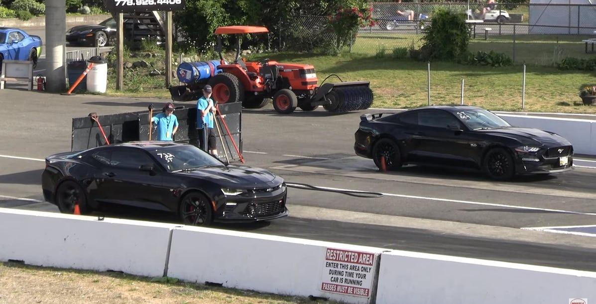 2019-ford-mustang-gt-vs-chevrolet-camaro-ss-drag-race-mission-raceway-hotcars.jpg