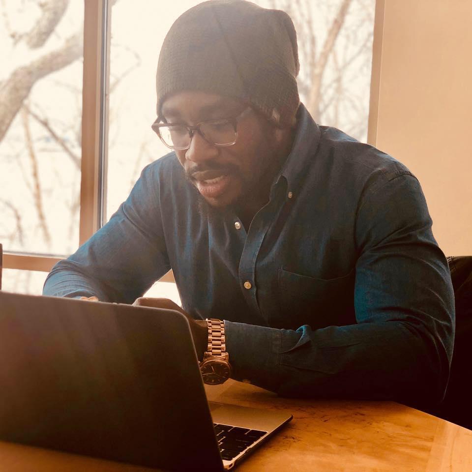 Derek Nnuro Writing Pic.jpg