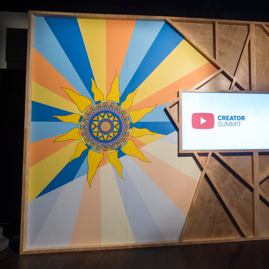 """The """"sun"""" mural (with the """"moon"""" mural featured on the opposite side of the stage), spanning 4.2m x 3.6m."""