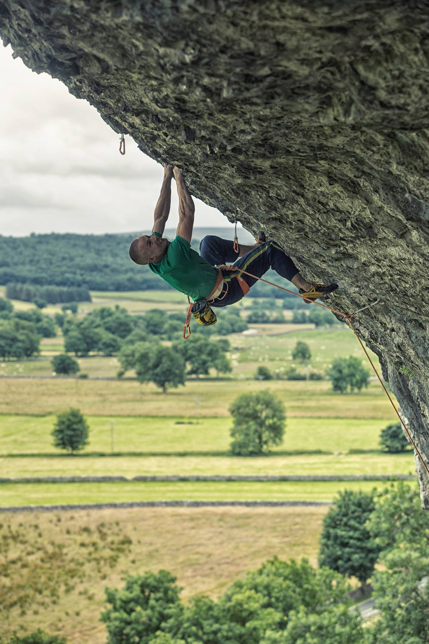 Setting up for the 'crucifix' crux of Freakshow 8c.  Photo: Copyright Lukasz Warzecha