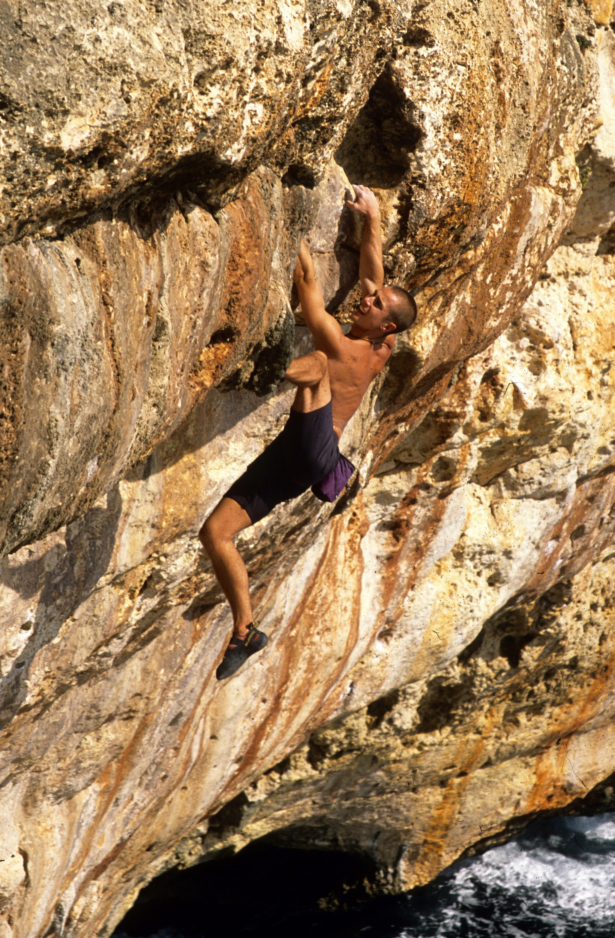 Pulling through the top bulge on the Lobster 6c+  Photo: Mike Robertson.
