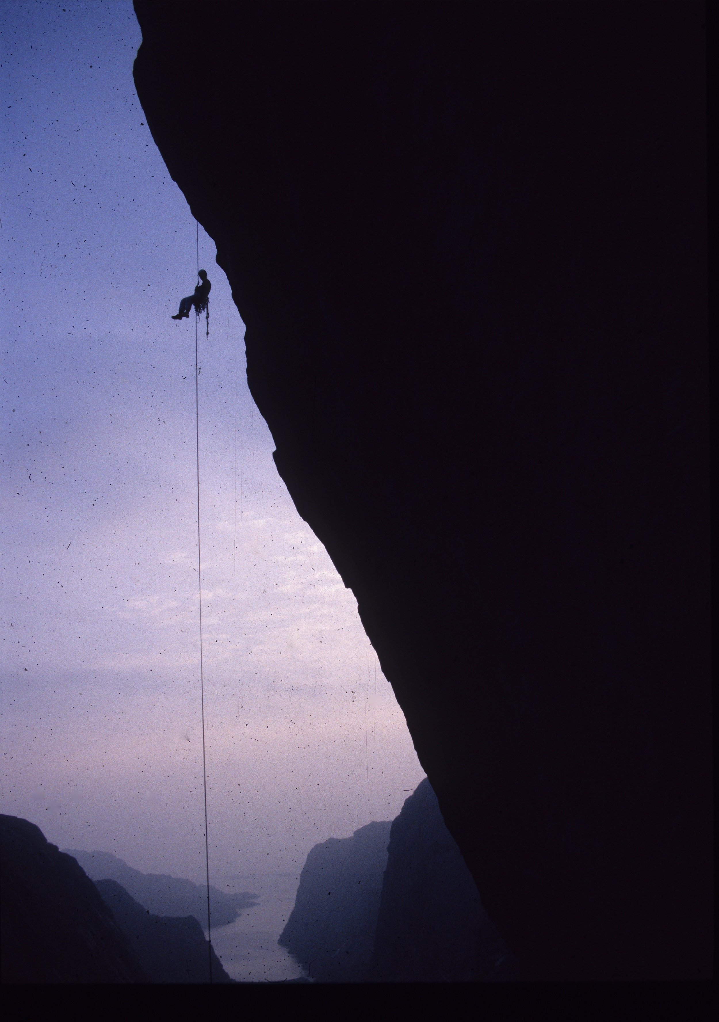Leo Houlding abseiling from Firefox E7 6b, 6c, 6a, Norway during our ascent in 1998.  Photo: Andy Cave