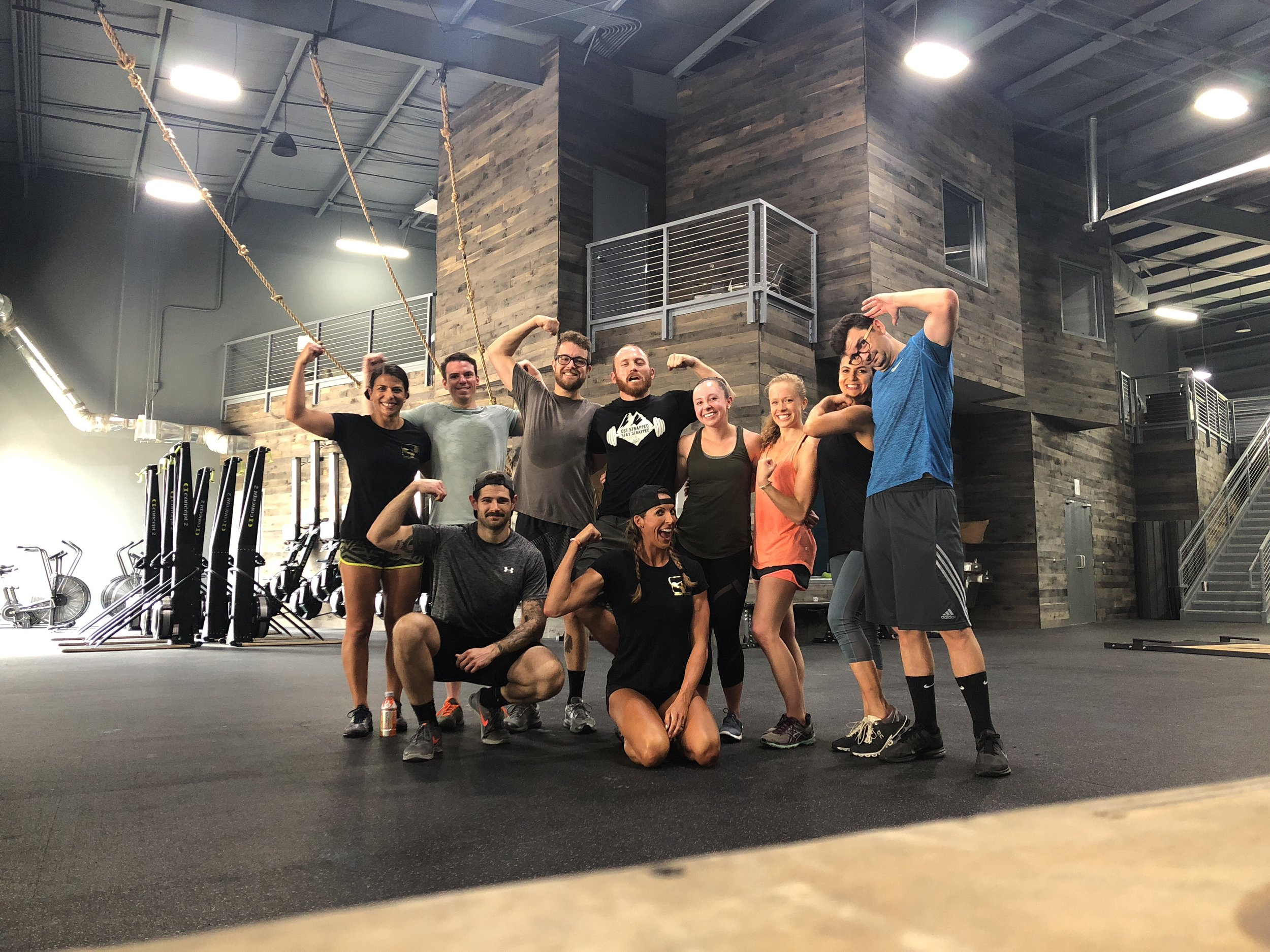 Past Event: 8/19/18 - STELLAR workout session at this month's Featured Gym, CrossFit Pushin Weight! The squad threw down with a Team Challenge... teams of two tackled the following workout with a 30 minute time cap. Part 1) Ascending Ladder - 1.2.3.4.5.6.7.8.9.10 Strict Barbell Press & 2.4.6.8.10.12.14.16.18.20 of a Kettlebell Goblet Squat. Part 2) AMRAP with 10 reps each of the following: parallette dips, box jumps, weighted sit ups, 10 calories on the assault bike, and v-ups... HUGE thanks to Coach Emine for such a kick-ass workout as well as Coach Ashley Jenkins of CFPW8 for having out our squad!