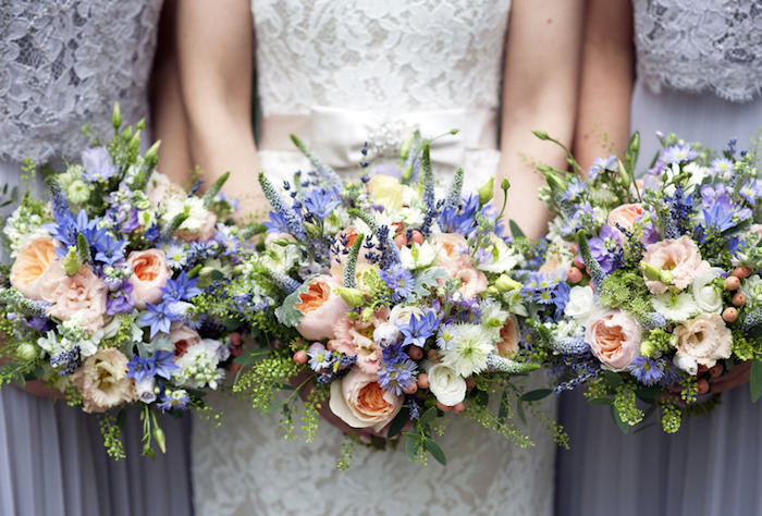 Pink and peach posies held by bride and bridesmaids.jpg
