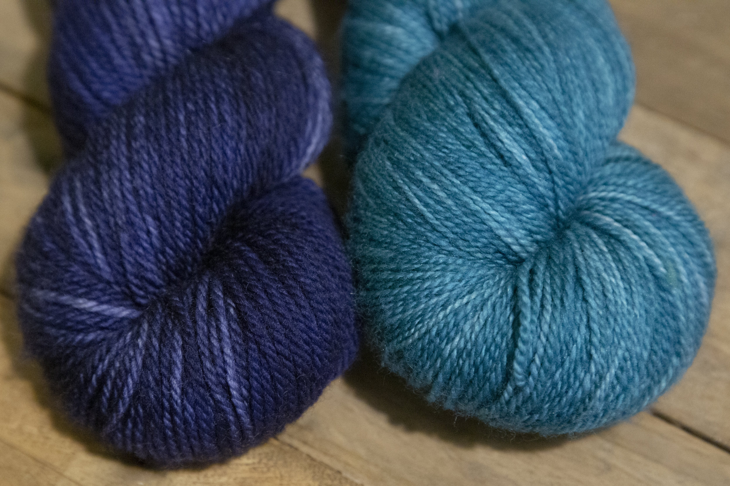 Two skeins of blue semi-solid yarn