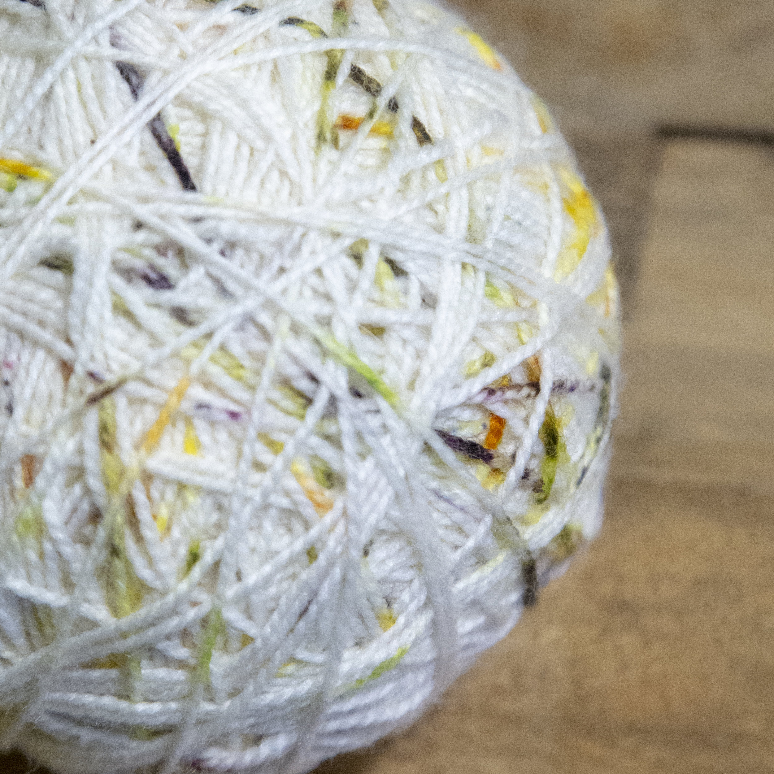 Ball of white speckled yarn