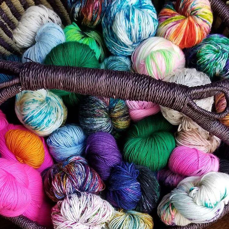 Many multi-colored skeins in a basket.