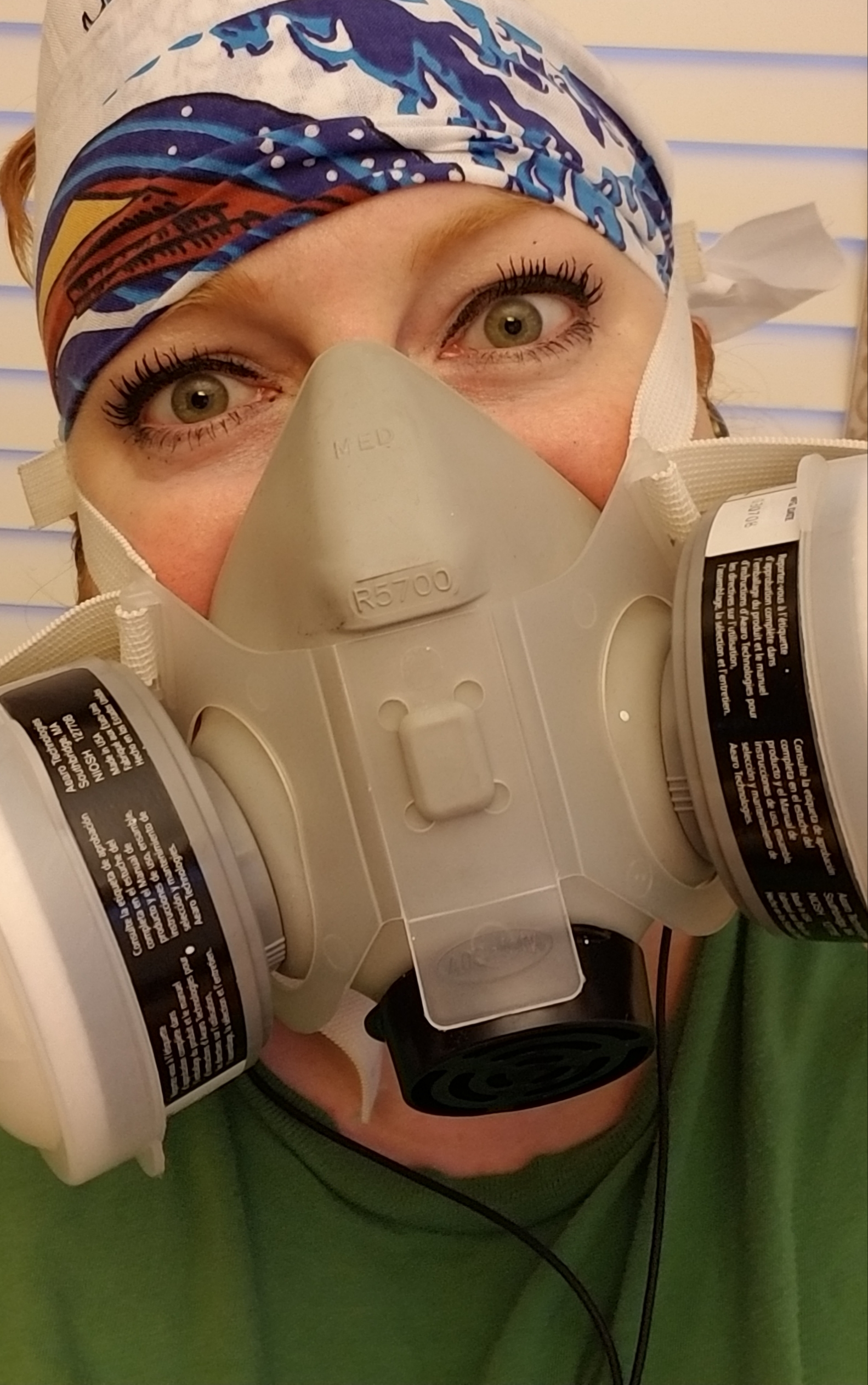 Anna Shores in a dust mask.