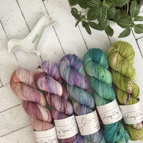 Five speckled skeins from Long Dog Yarn.