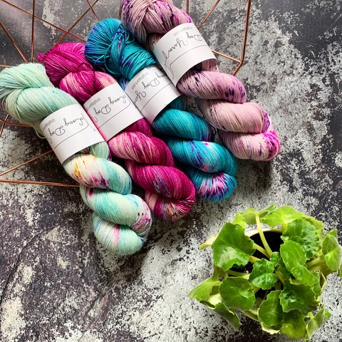 Four speckled skeins from Long Dog Yarn.