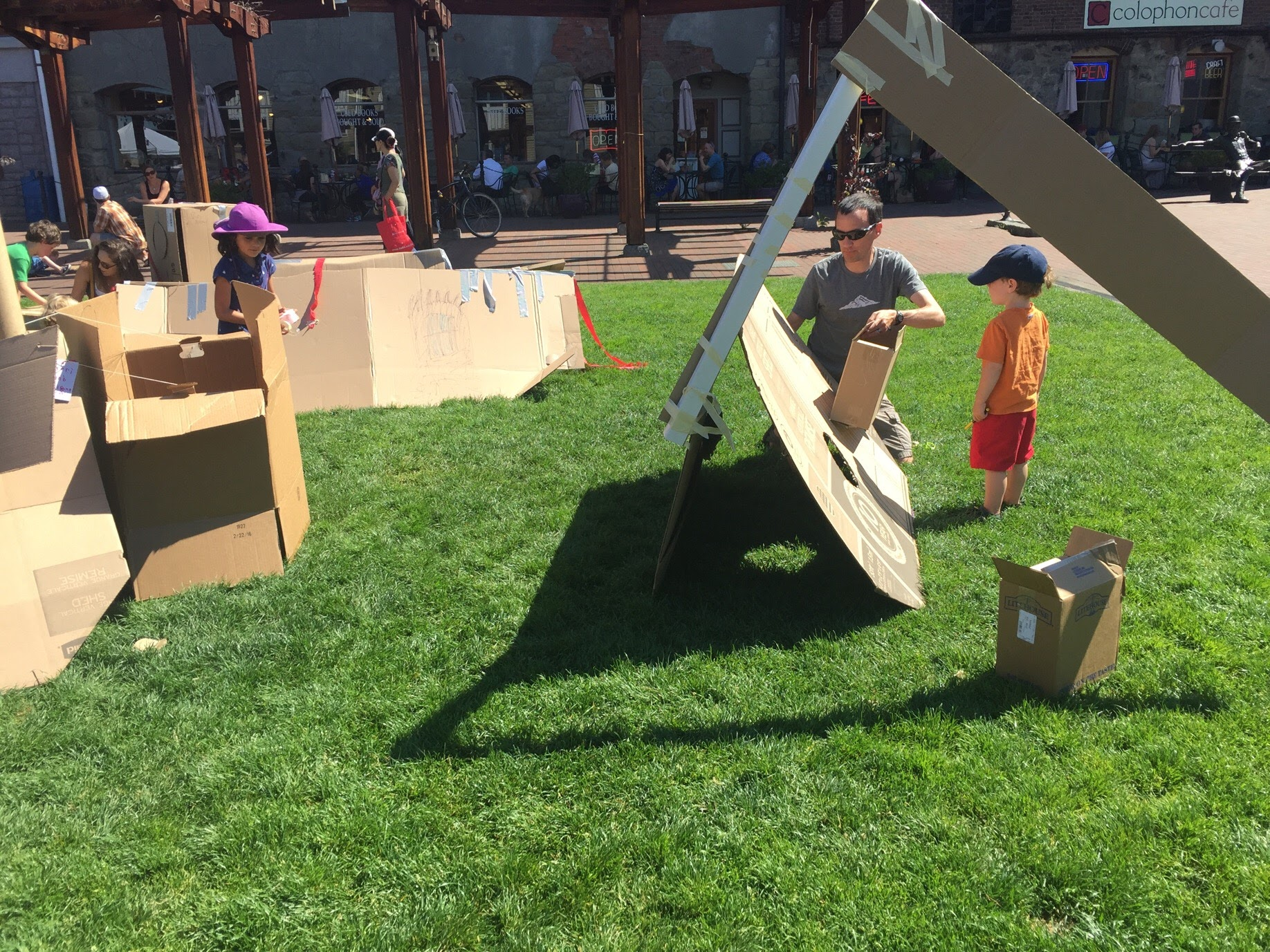 Playing together at a  Cardboard Playground  on the Fairhaven Green, 2017.
