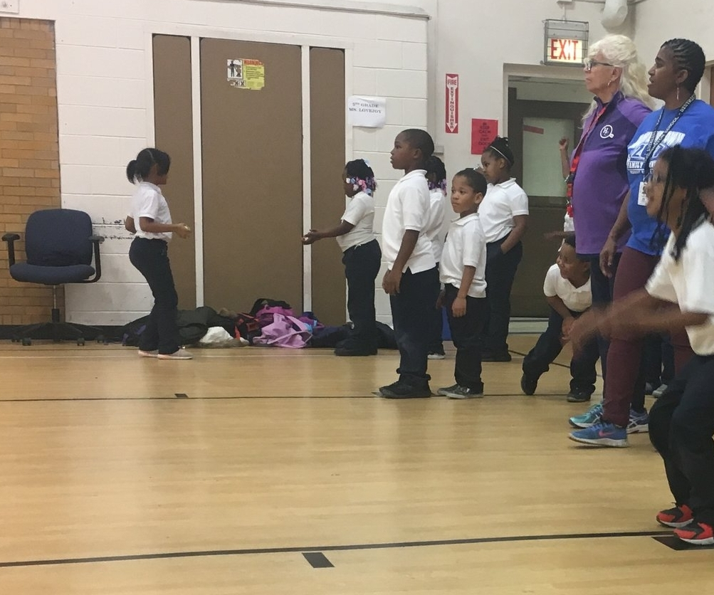 Coach Eaker leads the Kindergarten-3rd grade students through their warm-up routine at Washington Elementary School.