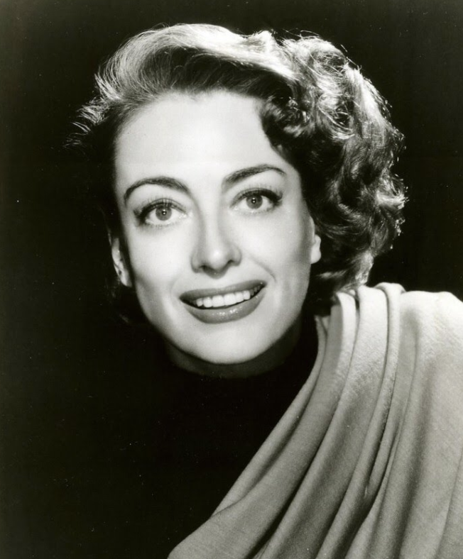 And here's pic of Joan Crawford smiling...for the road :)