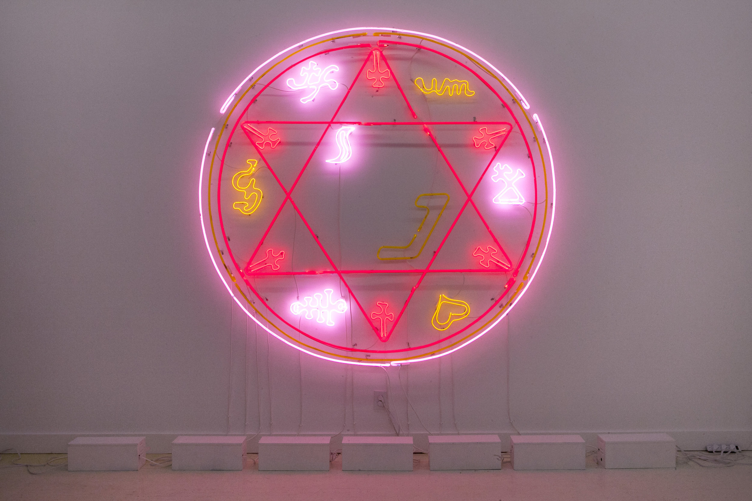 "Meryl Pataky  ""Invocation Through Fabrication (Success In Business / Trade), Key Of Solomon""  Glass Tubing, Neon, Argon, Helium, Transformers. 30 Units Of Glass. Circle - 8 x 8 Foot. 2018."