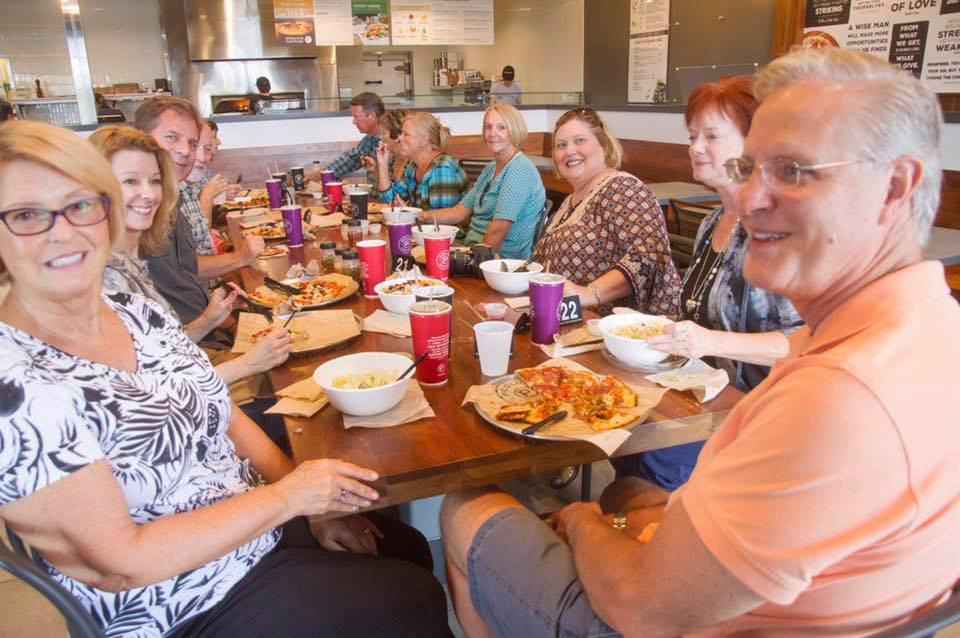The Hoeft LifeGroup enjoying a meal together.