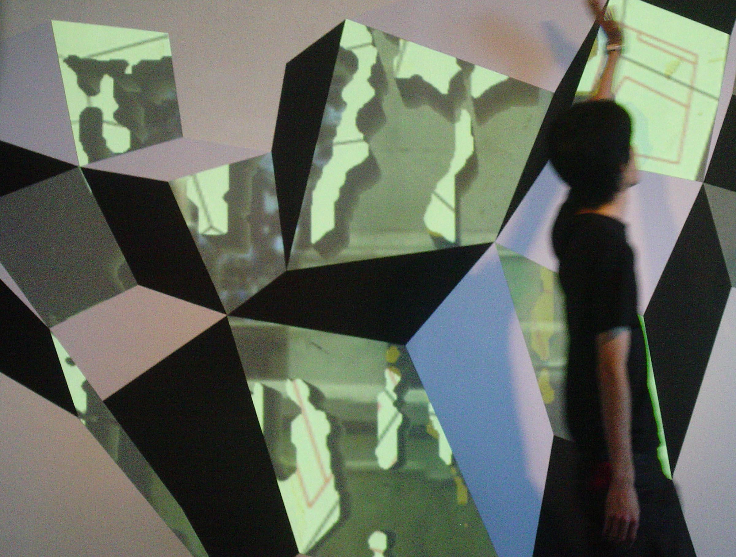 Fig.15 - Interactive RPT Wall Installation Nathan Cohen Ars Electronica Linz 2008: figure moving in front of installation triggering second video projection layer as seen through projector