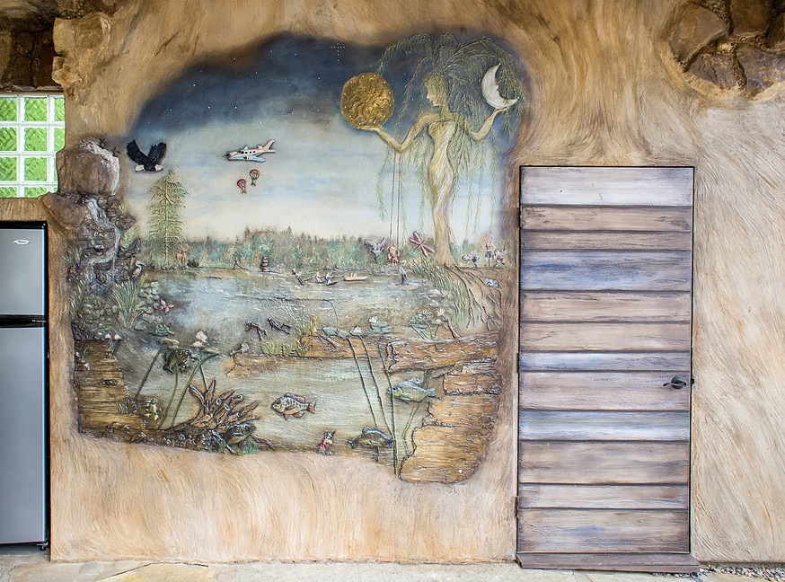 Custom outdoor mural, carved concrete