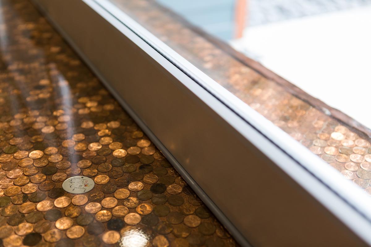 Closeup of custom indoor/outdoor penny top bar