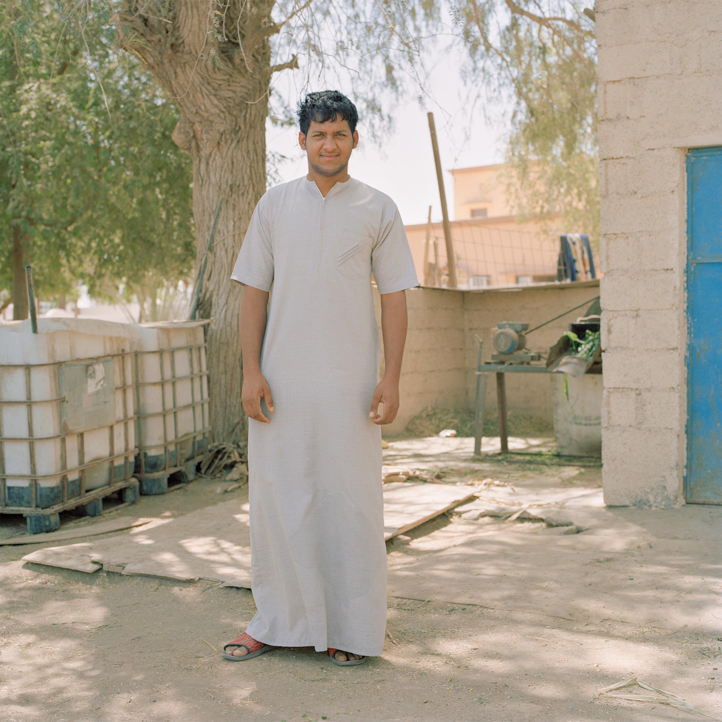 photograph of boy wearing dishdasha from series XO