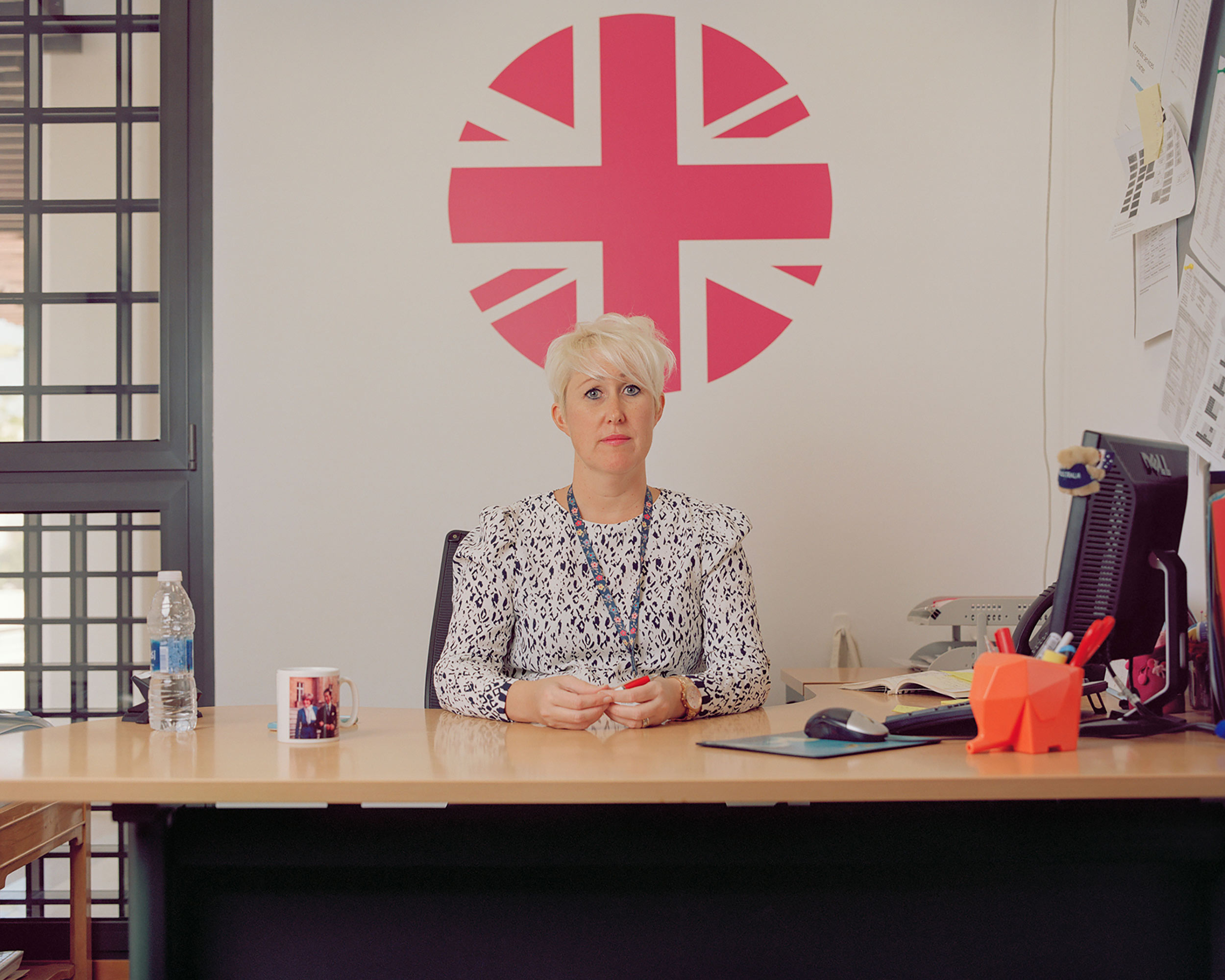 photograph of lady at desk from series XO