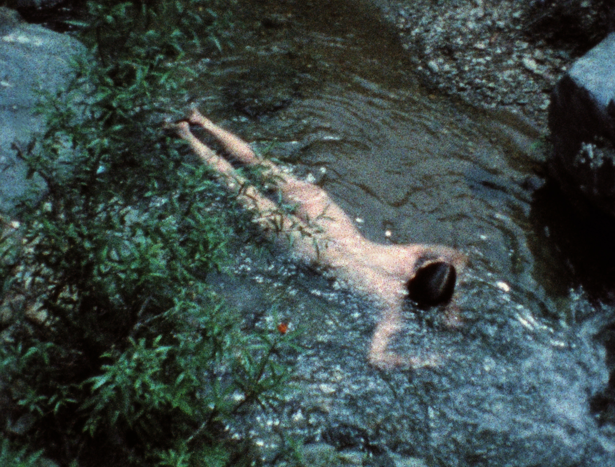 Ana Mendieta  Creek , 1974, Still from super-8mm film transferred to high-definition digital media, color, silent. Running time:3:11 minutes. © The Estate of Ana Mendieta Collection, LLC. Courtesy Galerie Lelong & Co.