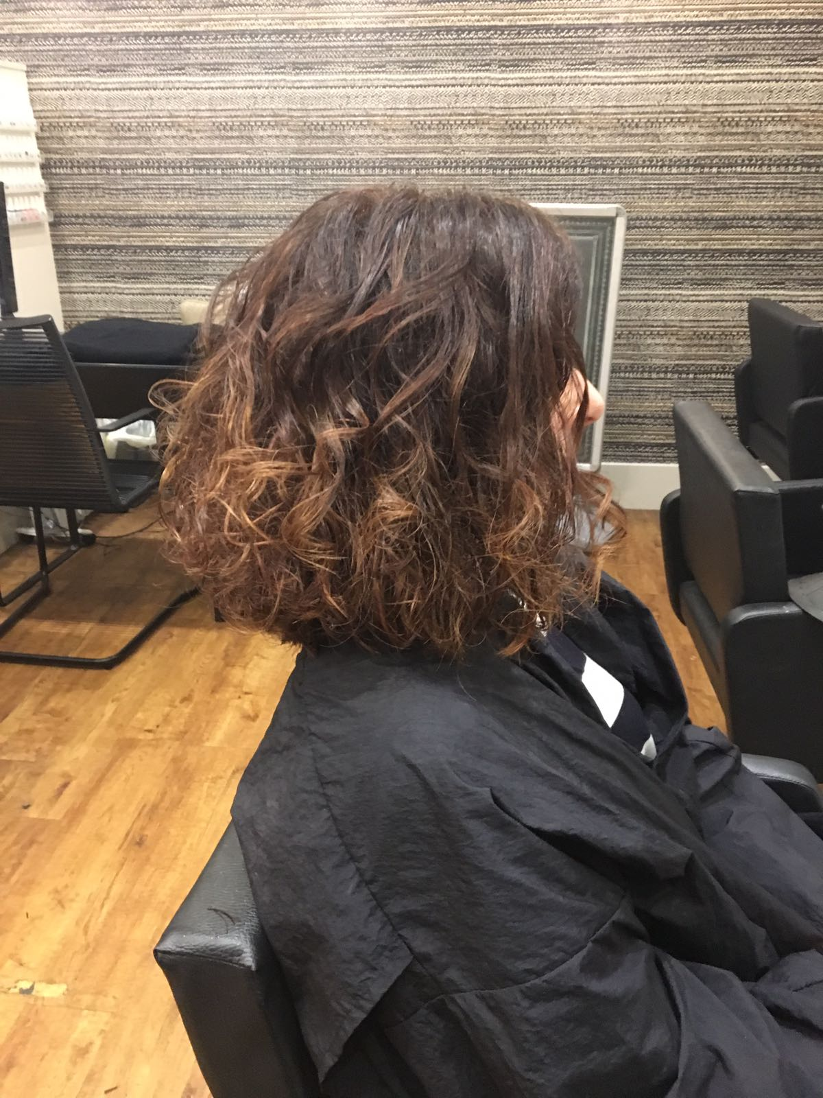 Brown tonal colour with rich warm copper slices.  Cut to accommodate natural curly hair and to create volume..jpeg