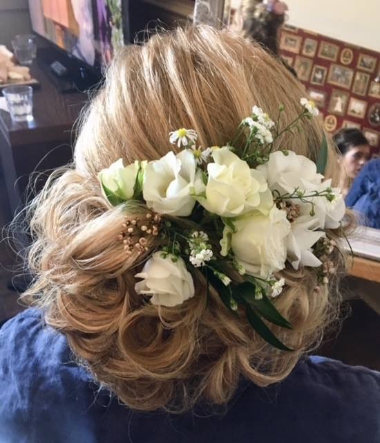 Soft bridal hair up with flowers