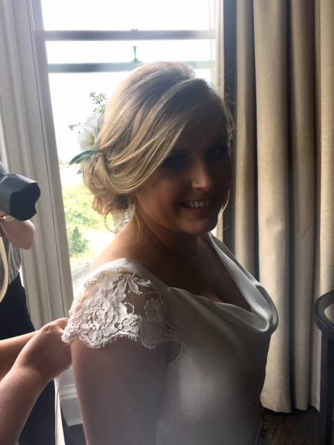 Softly pinned back bridal look