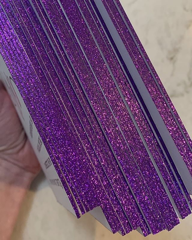 💜💜YESSSS!💜💜 edge-y studio vibes today @designereventchicago #purpleglitter #edges #custominvitations #tinypeek #behindthescenes #luxury #luxuryinvitations