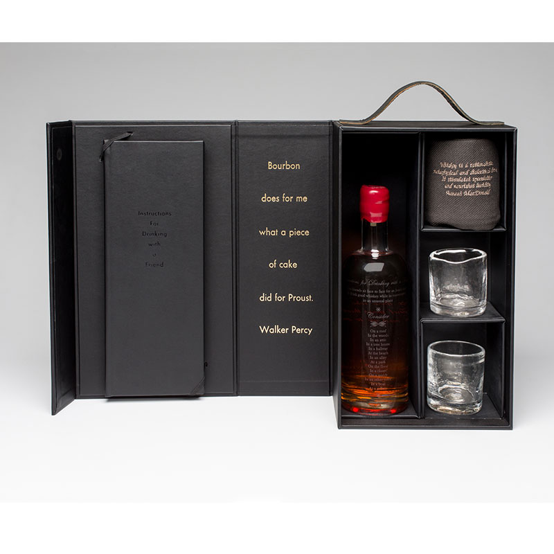 """Instructions for Drinking with a Friend , 2016 instruction book, custom distilled whiskey, hand blown & etched bottle, two hand blown glasses, embroidered towel, custom case dimensions variable, 14 x 8.5 x 5"""" box Edition of 12, 1AP  Inquire >"""