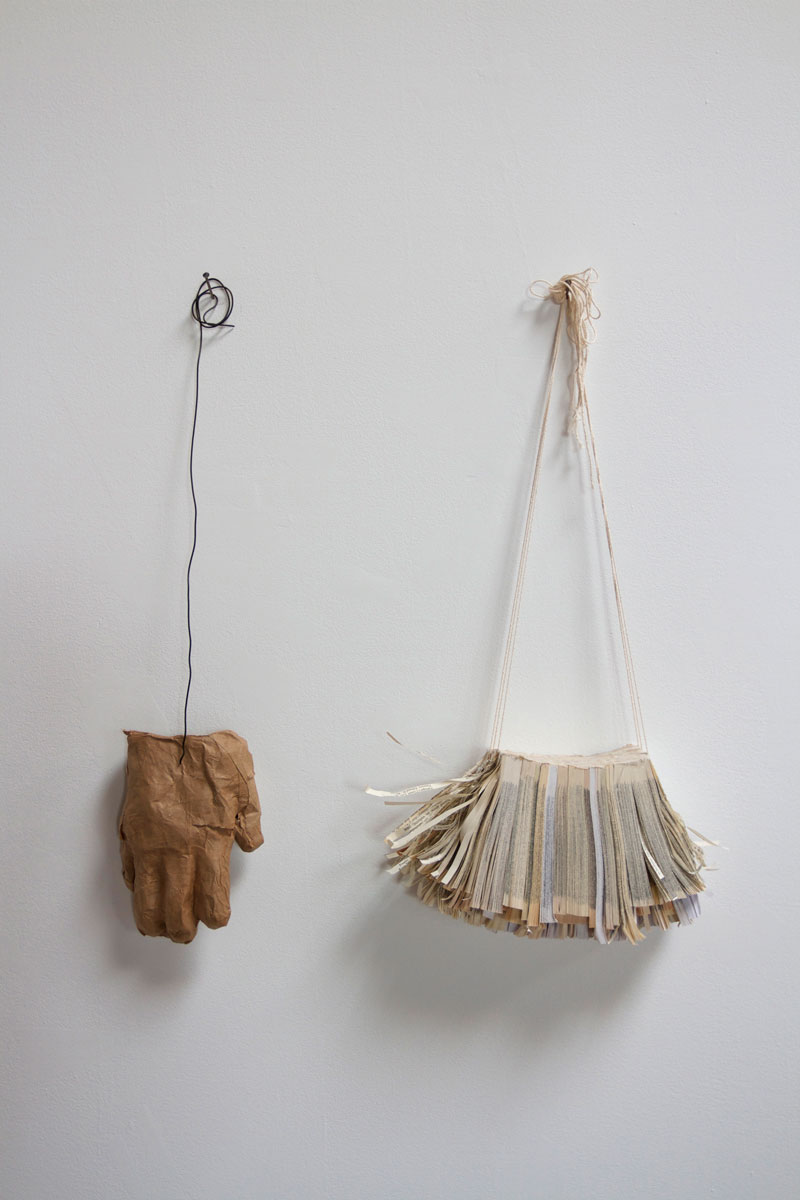 """near-away , 2013 paperback book slices, cheese cloth, string, bookbinders glue, brown kraft paper, methyl cellulose, and steel wire 23 x 20.5 x 3"""" Edition of 26, 5AP"""