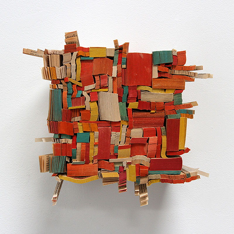 """Afterword , 2014 paperback book slices, wood, bookbinder's adhesive 8 x 8 x 5""""  Inquire >"""