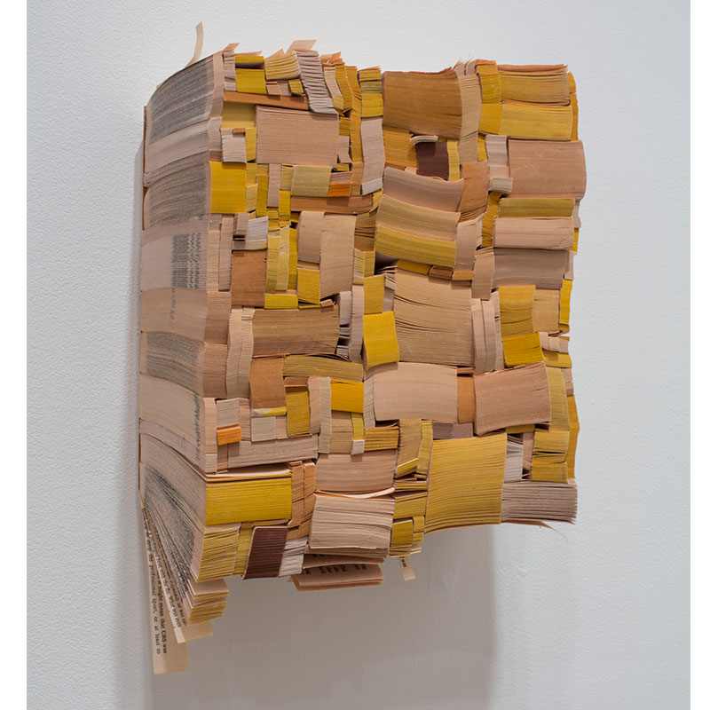 """Word , 2013 paperback book slices, wood and bookbinder's glue 9.5 x 8.75 x 4""""  Inquire >"""