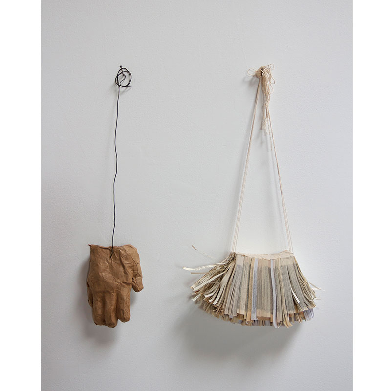 """near-away , 2013 paperback book slices, cheese cloth, string, bookbinders glue, brown kraft paper, methyl cellulose, and steel wire 23 x 20.5 x 3"""" Edition of 26, 5AP  Inquire >"""