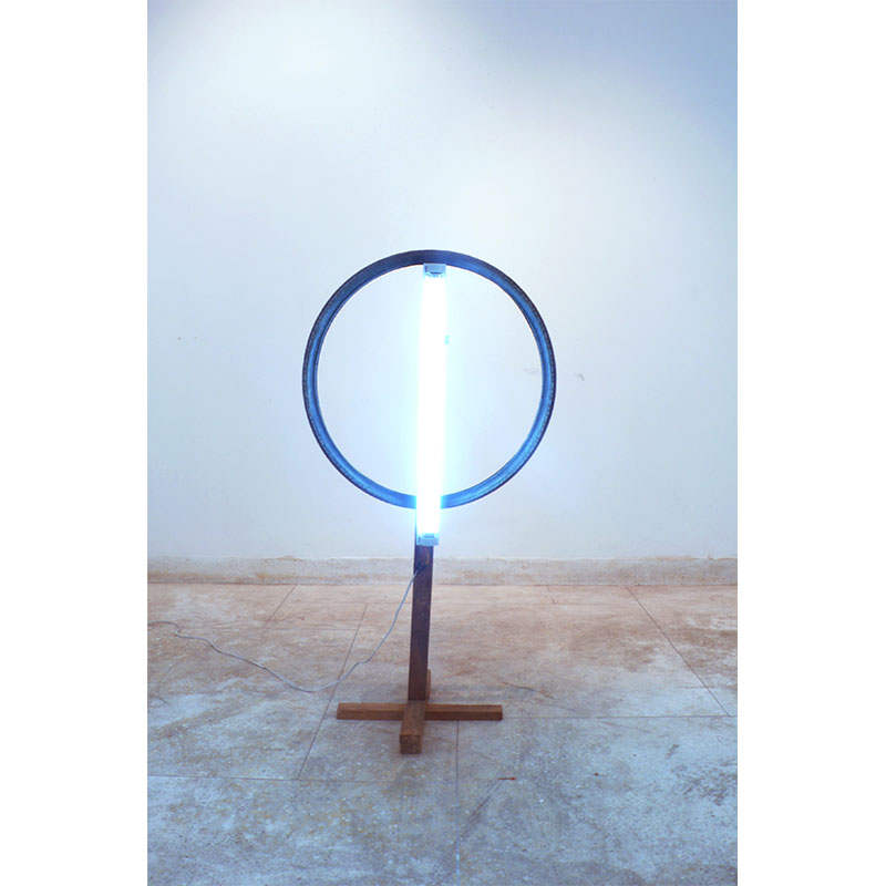 """Halo in the Night , 2009 tire, florescent light, wood 44 x 23.5 x 16"""" Edition of 3  Inquire >"""