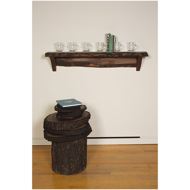 Dinner for Crying , 2012 artist book, wood shelf, six walnut plates, three walnut platters, walnut stump, four selected books, and six etched glass beer steins.  Inquire >